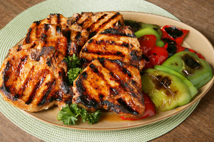 Grilled center cut pork chops with blackend sweet peppers