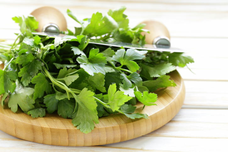Fresh fragrant green parsley on a cutting board