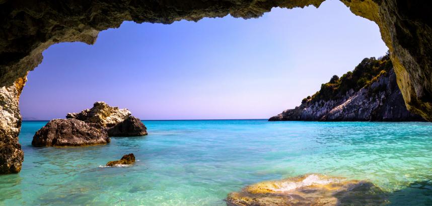Panoramic cave framing turquoise sea