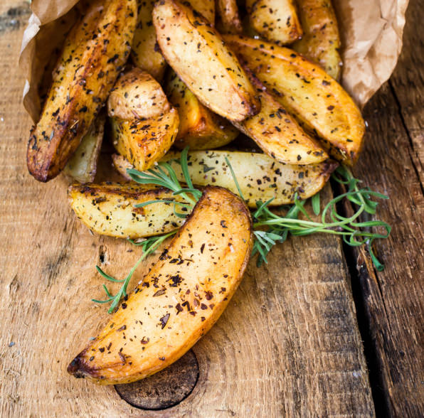 pile of French fries potato wedges with herbs