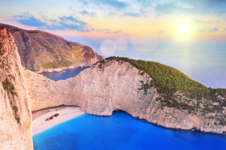 Zakynthos island with shipwreck on beach, at sunset