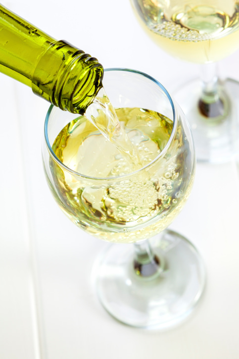 Glass of White Wine Being Poured