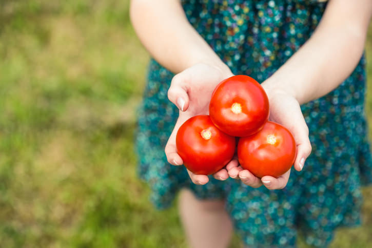 Woman holding some tomatoes