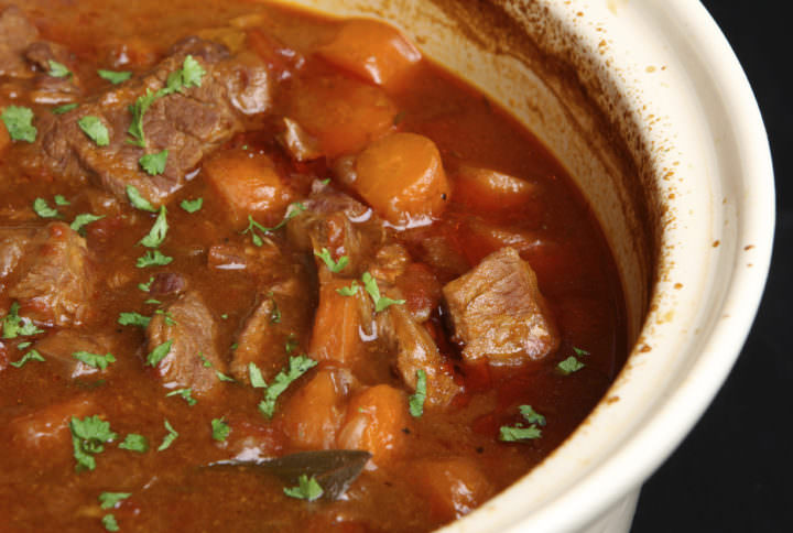 Slow-cooked beef stew in casserole dish.