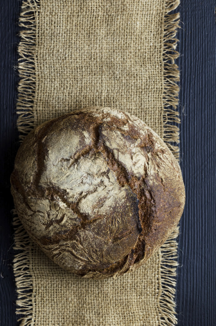 Traditional bread over burlap, above view