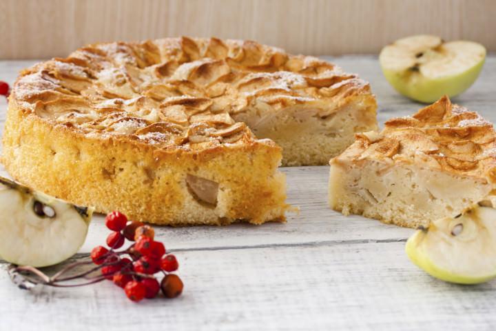 autumn Apple pie with powdered sugar on white background