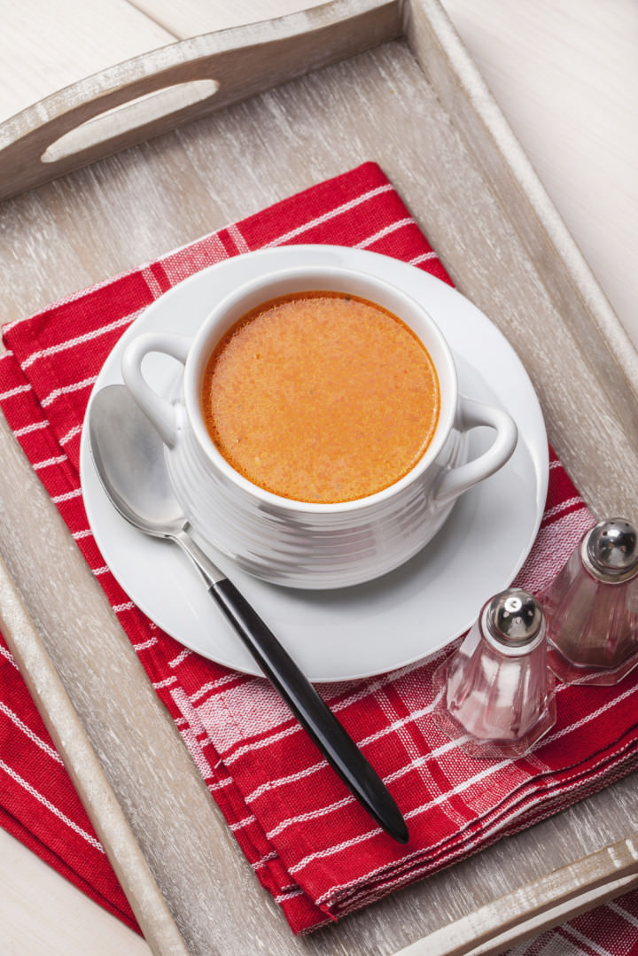 Fresh tomato soup in a white bowl. Selctive focus.
