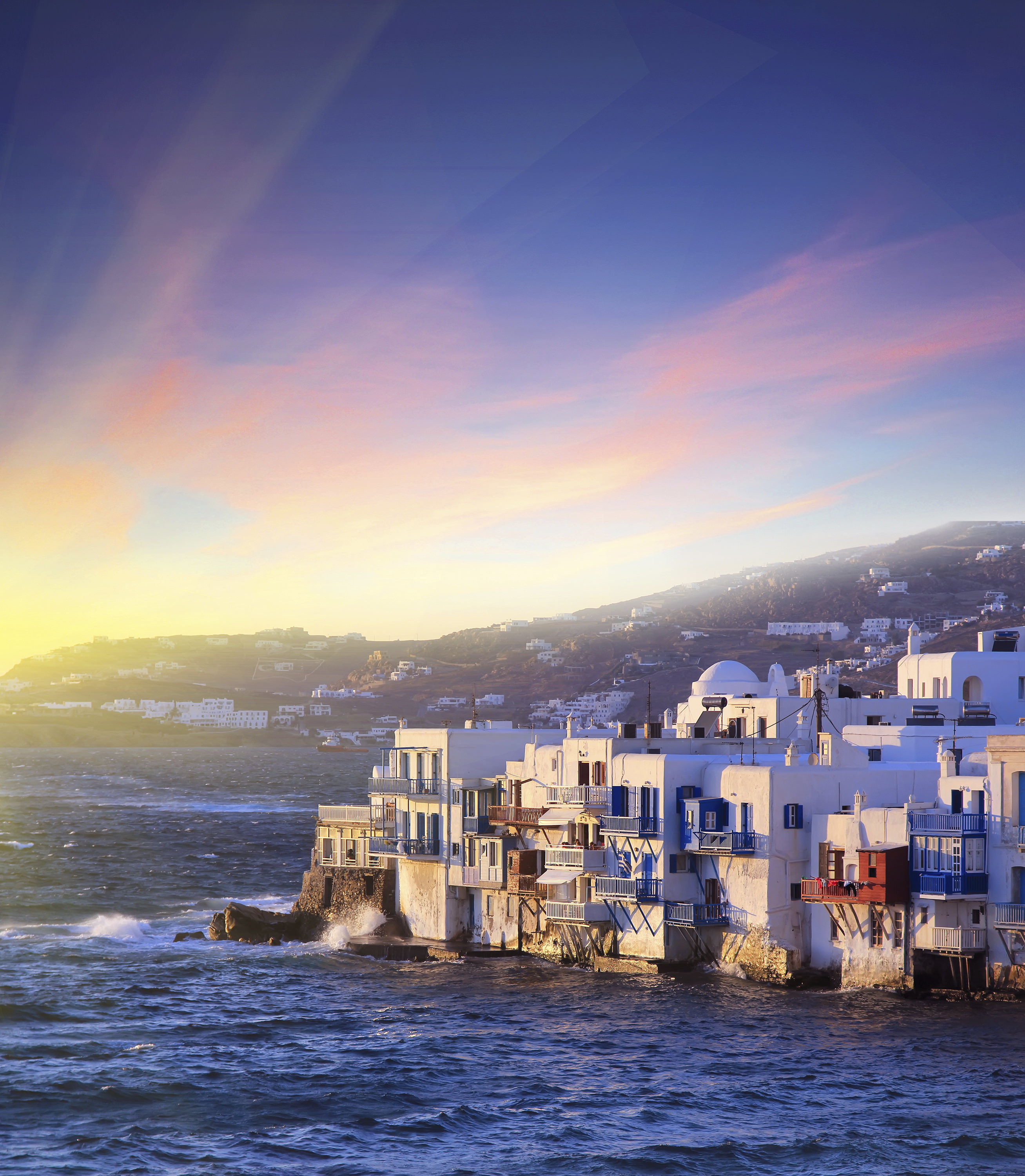 Colorful Little Venice of Mykonos island at  sunset , Greece . Travel background