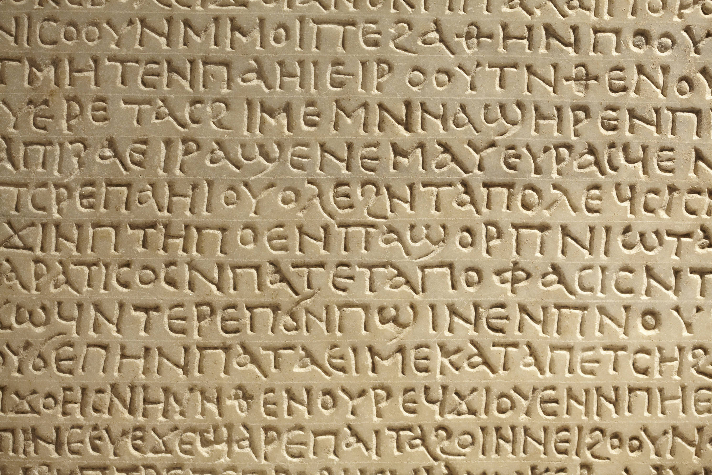 Ancient greek writing on stone background