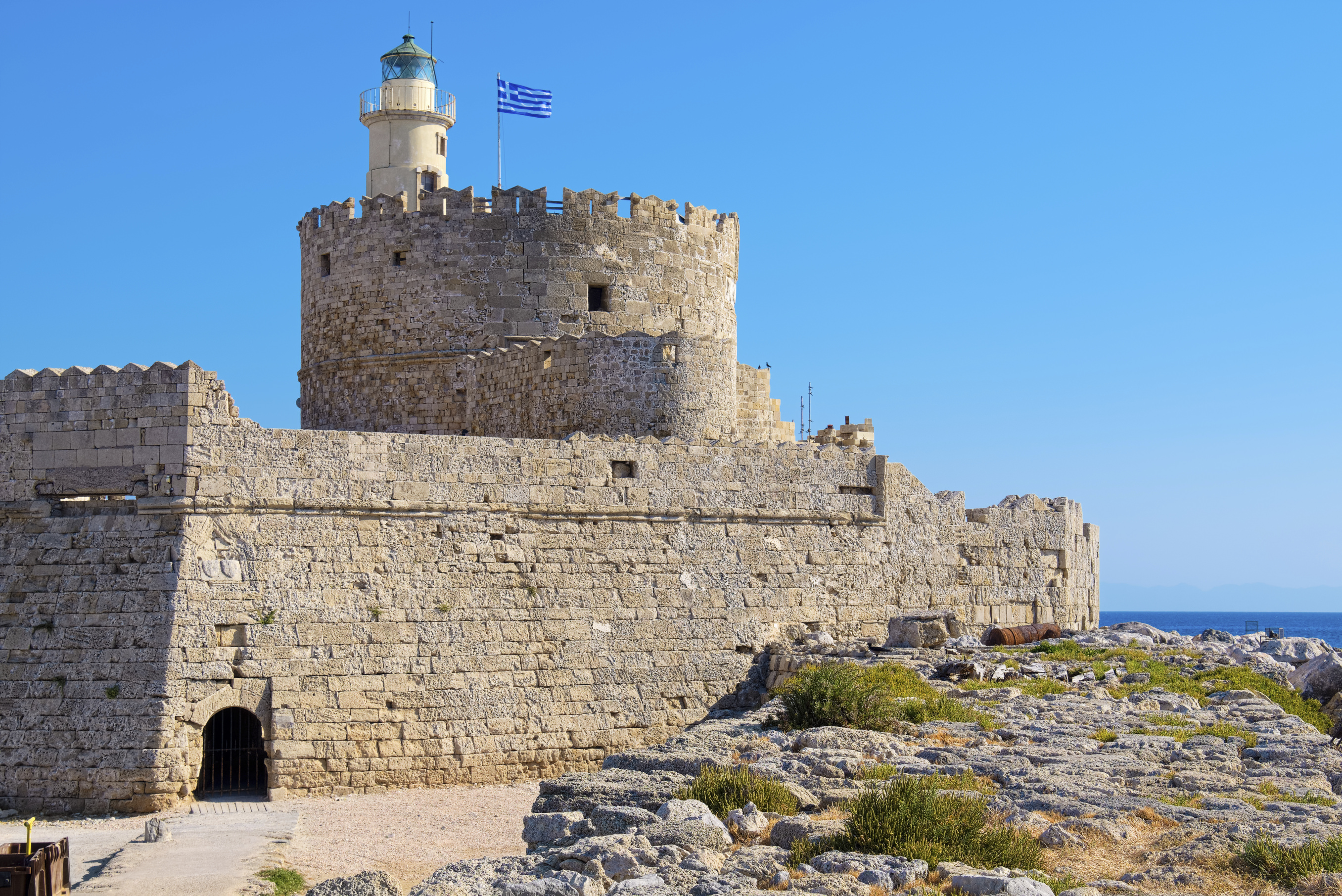 Old Agios Nikolaos fortress and lighthouse in Mandraki Harbour. Rhodes, Dodecanese, Greece