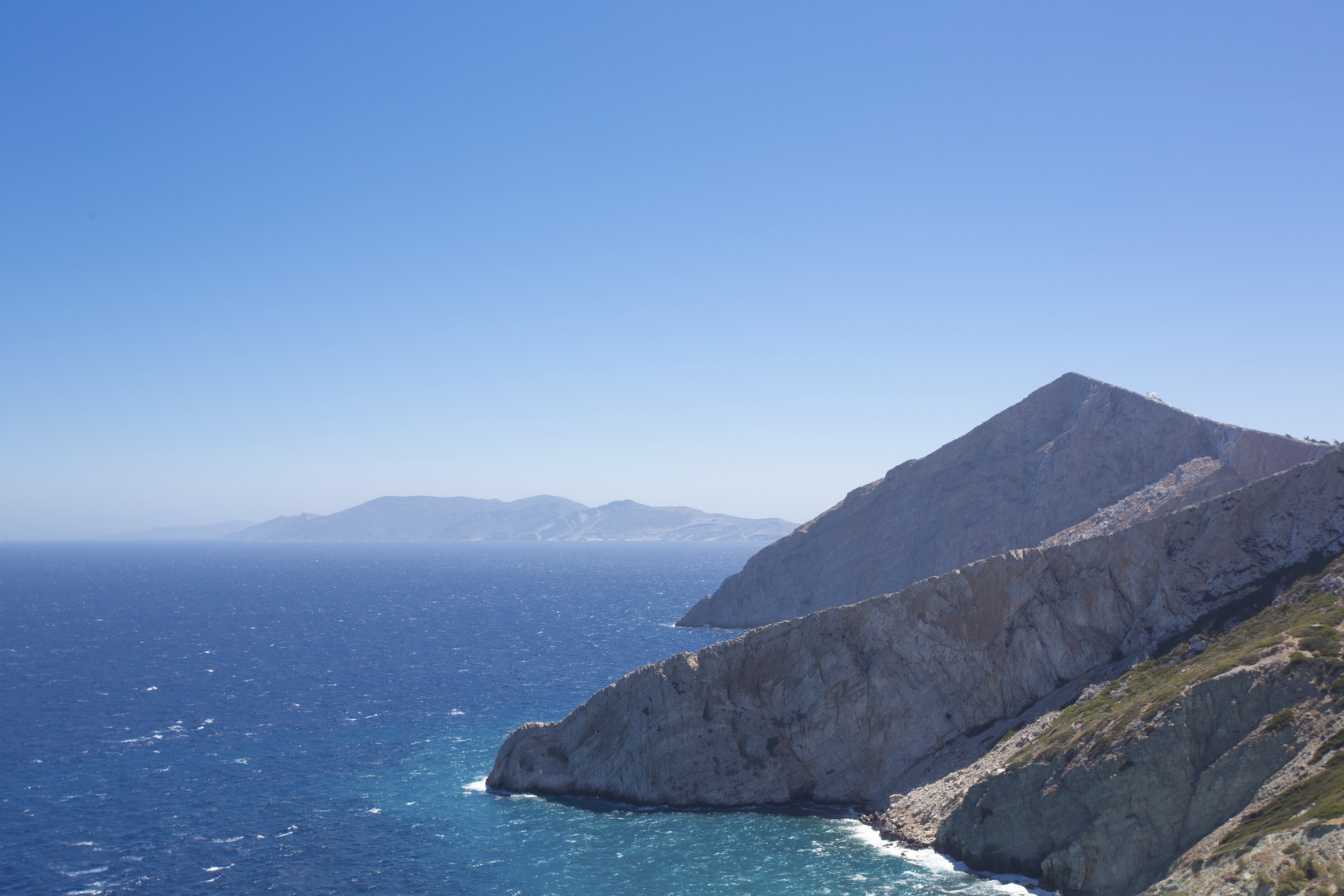 Beautiful view of the shoreline, the Aegean sea and the rocky mountains of Folegandros, an amazing island from Greece 2013.
