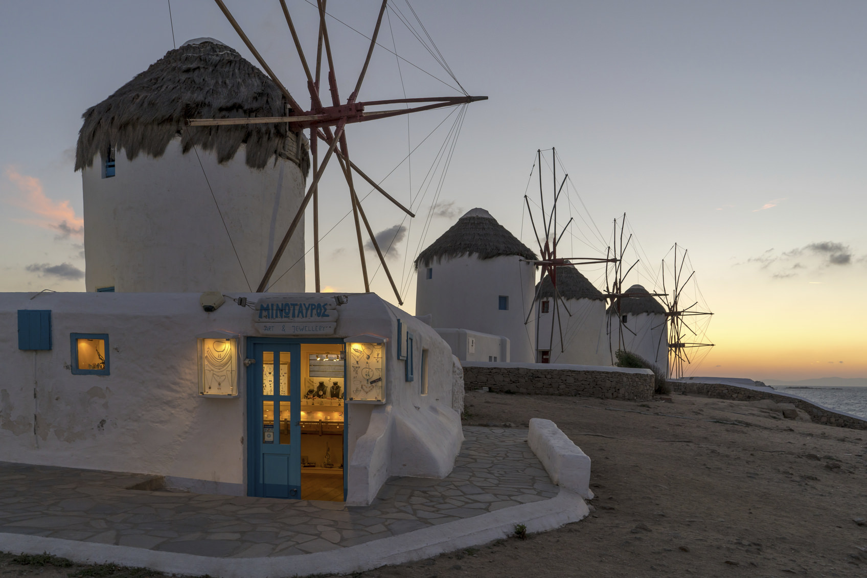 Mykonos Island, Greece - October 14, 2015: Mykonos is a travel location of mediterraneon cruise tour, where almost all the houses are painted in white and doors, windows and stairs are in blue. There stands windmills on the hill facing the sea, which look apparently imitations but fascinate tourists.