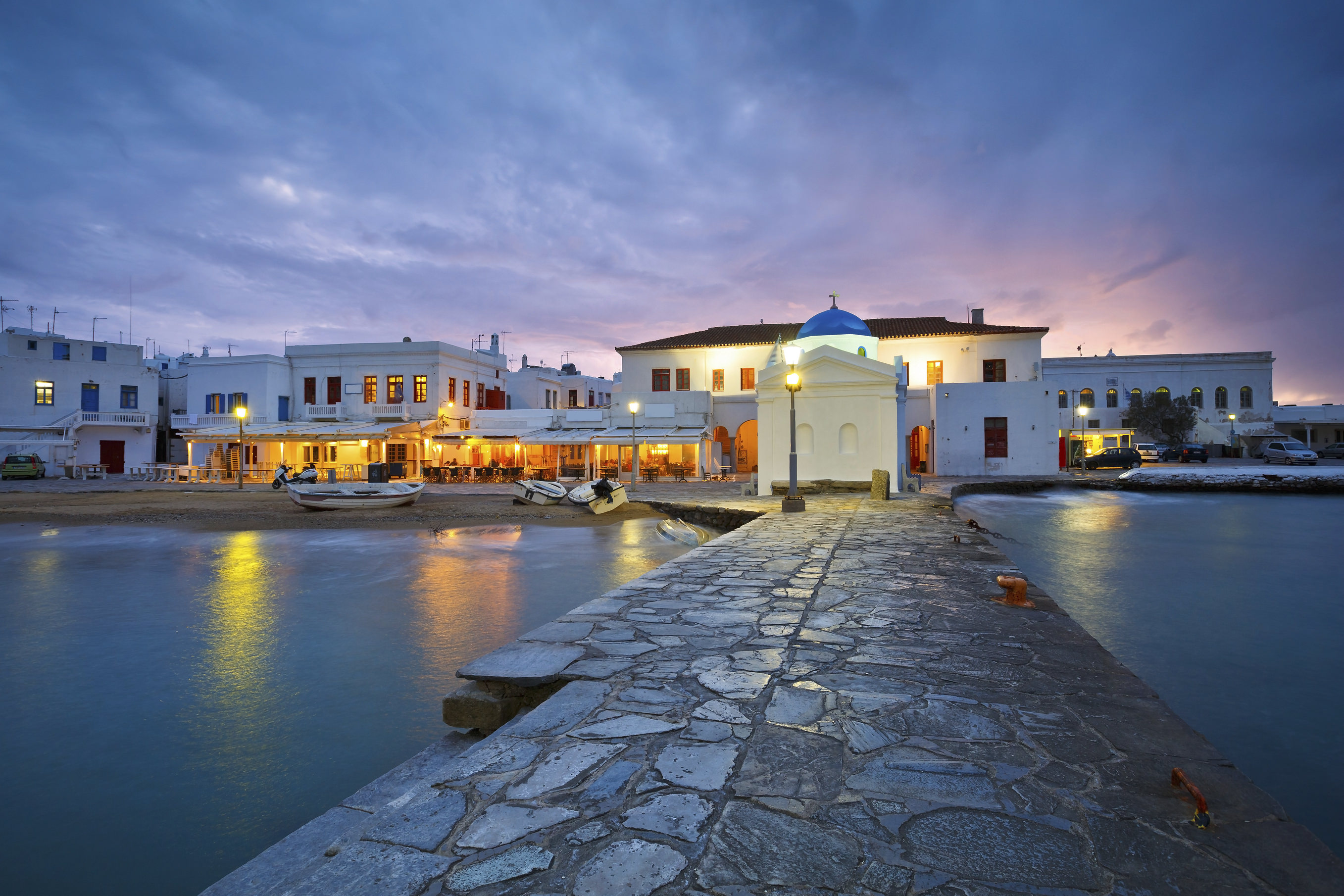 Town of Mykonos as seen from the old harbor. Image shows charateristi architecture of the old town.