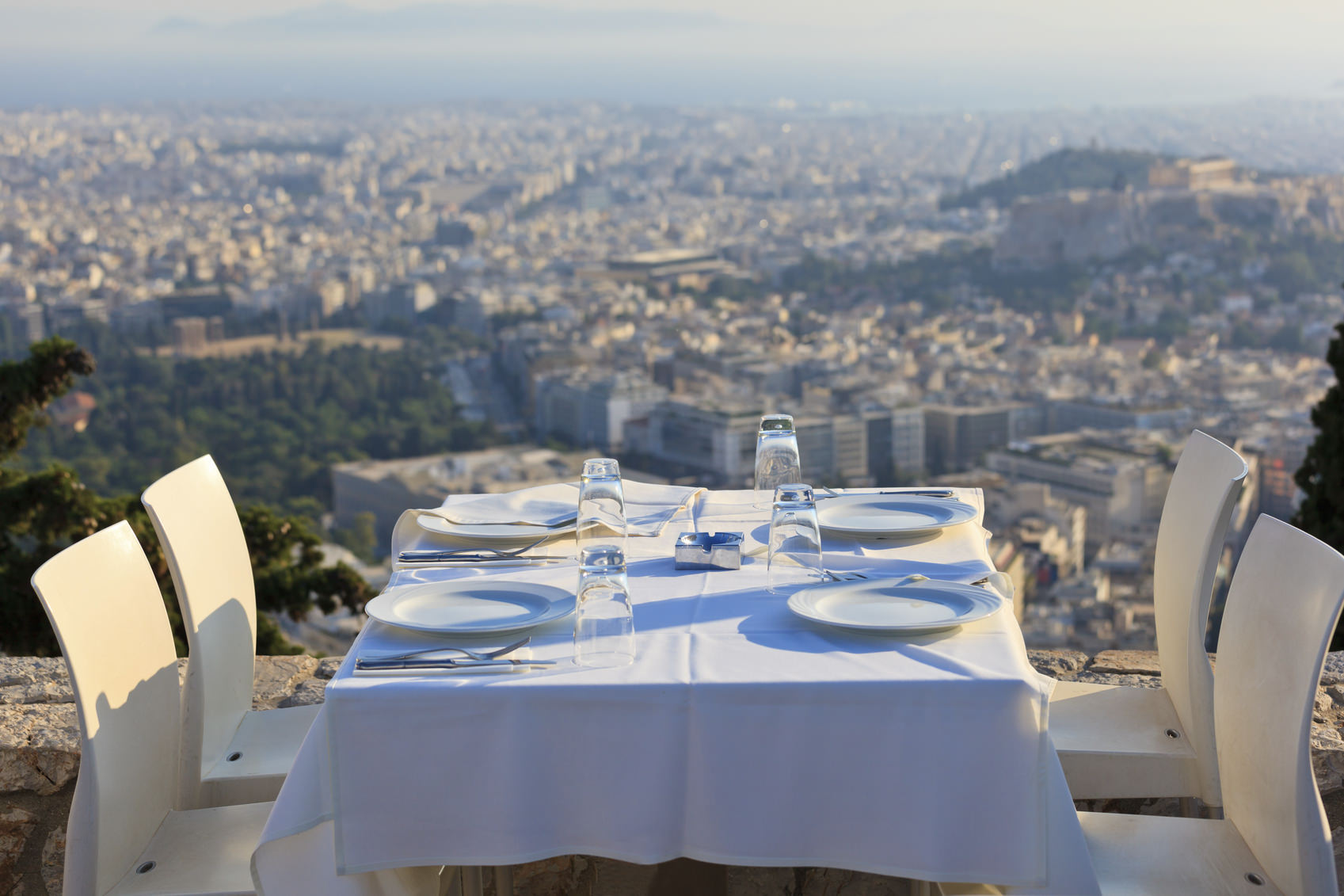 restaurant tables with panoramic view of athens town, lycabetus hill