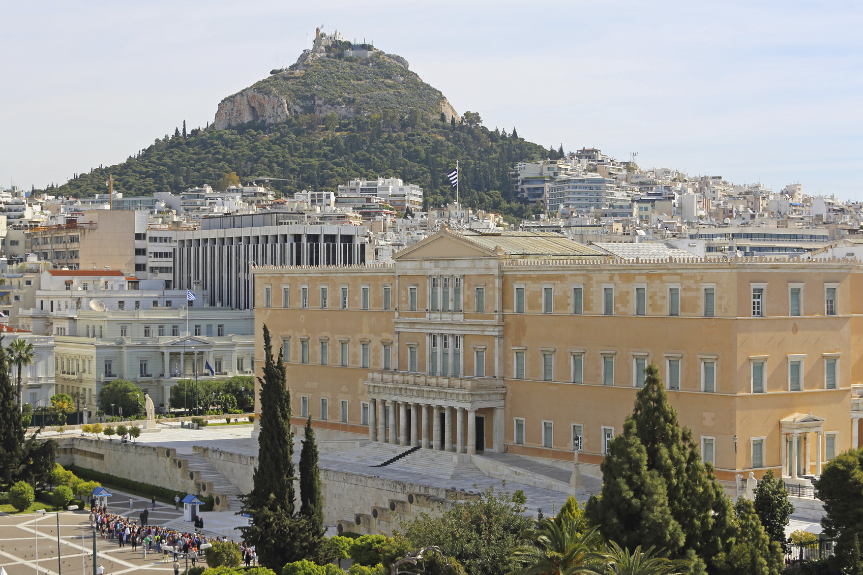 Athens, Greece - May 02, 2015: Tourists in front of Greek Parliament and Mount Lycabettus in Athens, Greece.