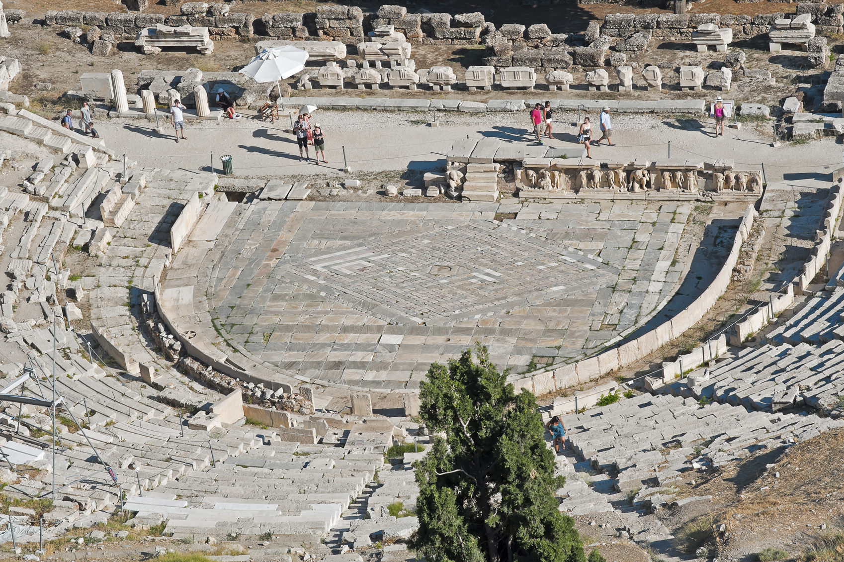 Athens, Greece - July 31, 2014: Remains of the Theater of Dionysus Eleuthereus on July 31, 2014 in Athens, Greece attracts tourists from all over the world.