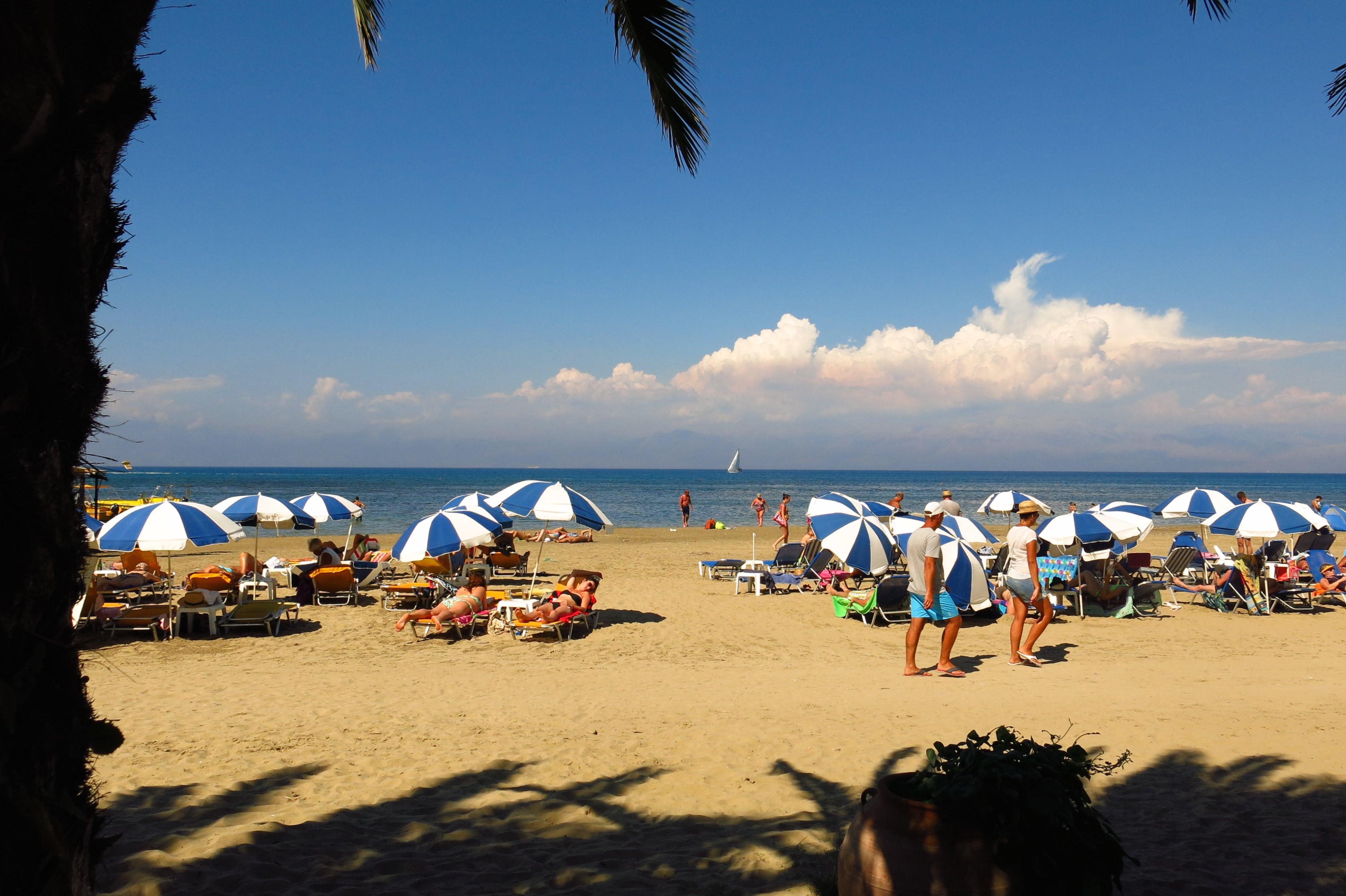 Corfu, Greece - August 31, 2014: Sunbathers relax on Sidari beach on the Greek island of Corfu.