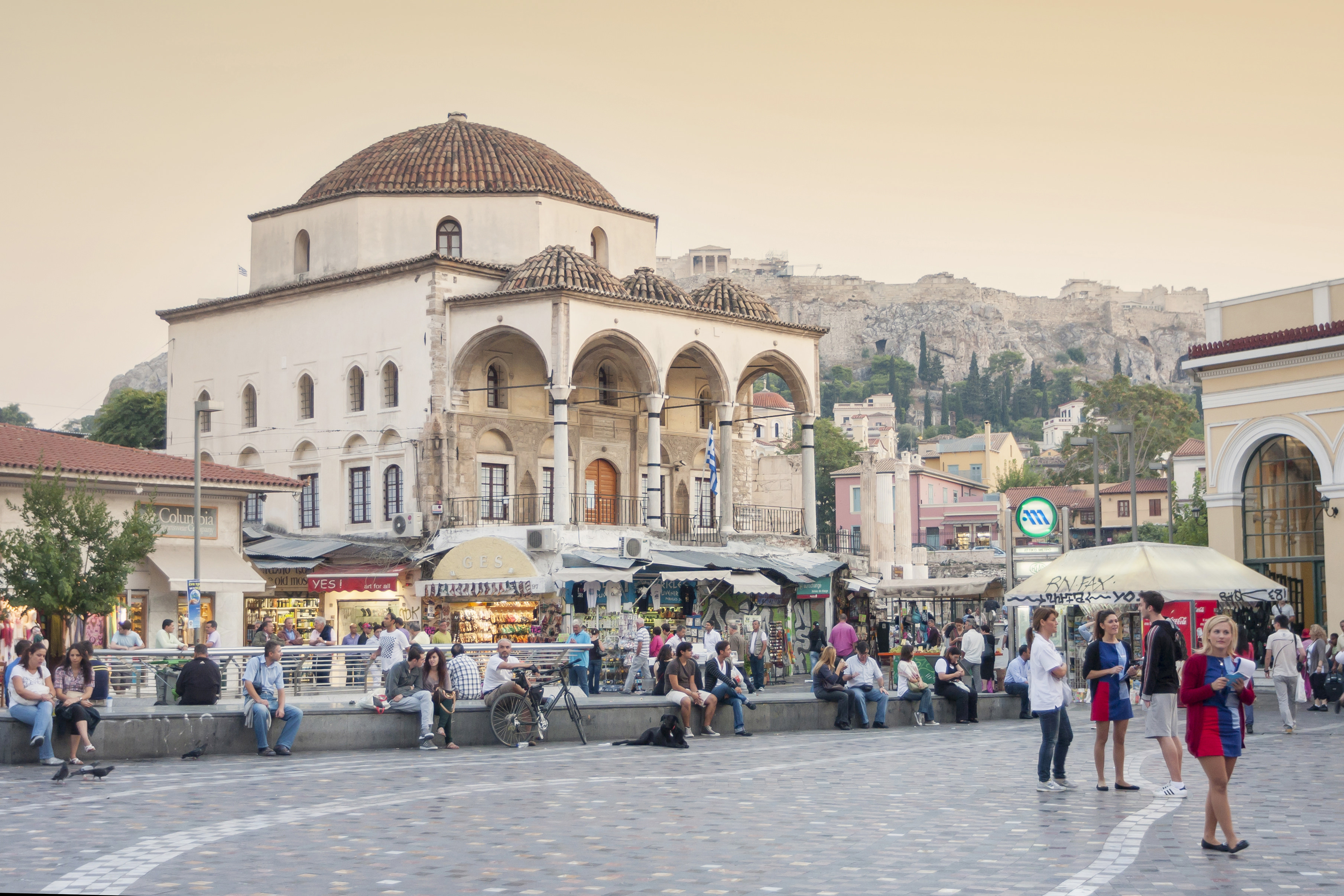 Athens, Greece - October 5, 2011 : People sitting and resting in front of the Tzistarakis Mosque in Monastiraki Square in central Athens, Greece.