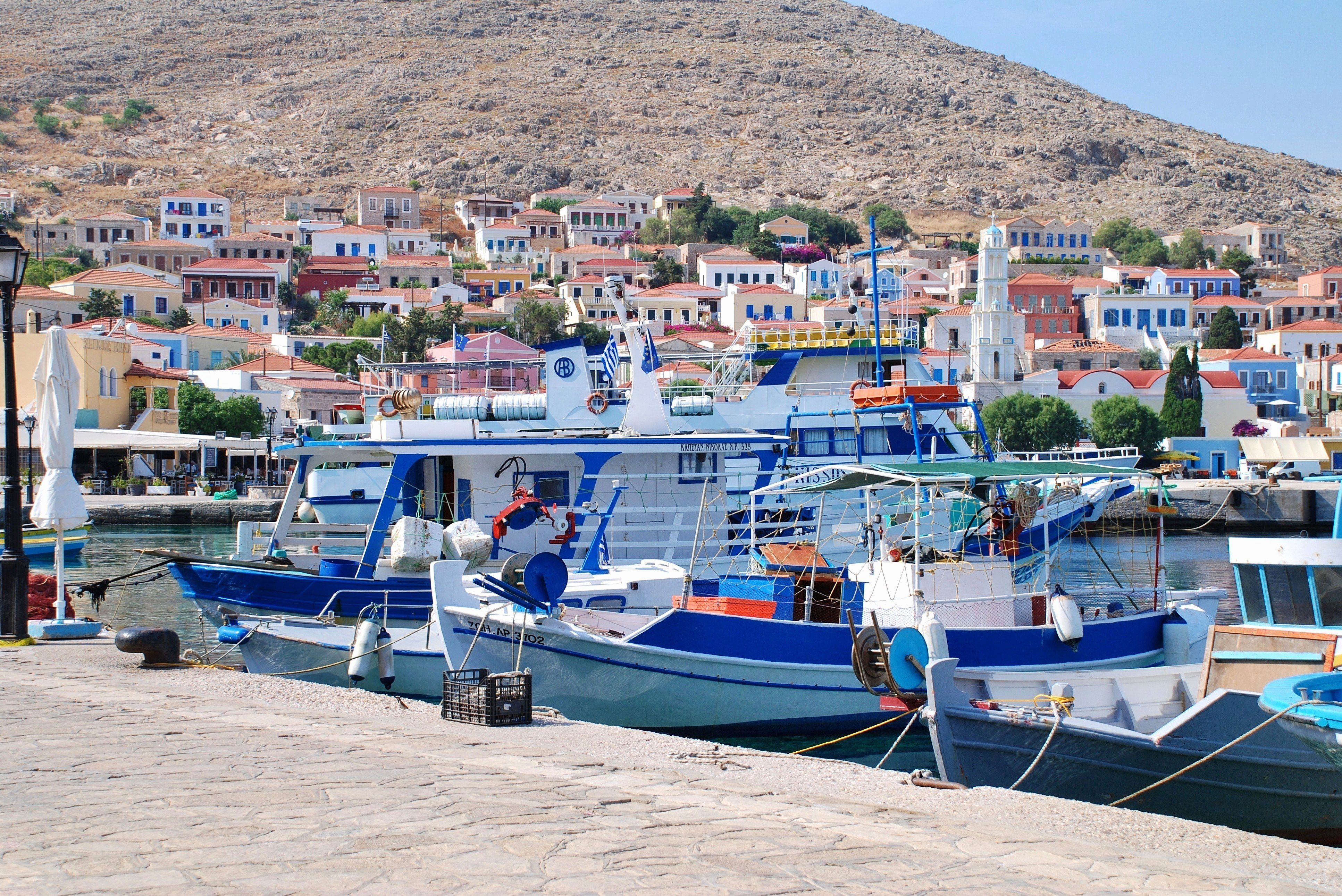 Halki, Greece - June 5, 2015: Small boats moored in the harbour at Emborio on the Greek island of Halki. The Dodecanese island has a population of less than 300 people.