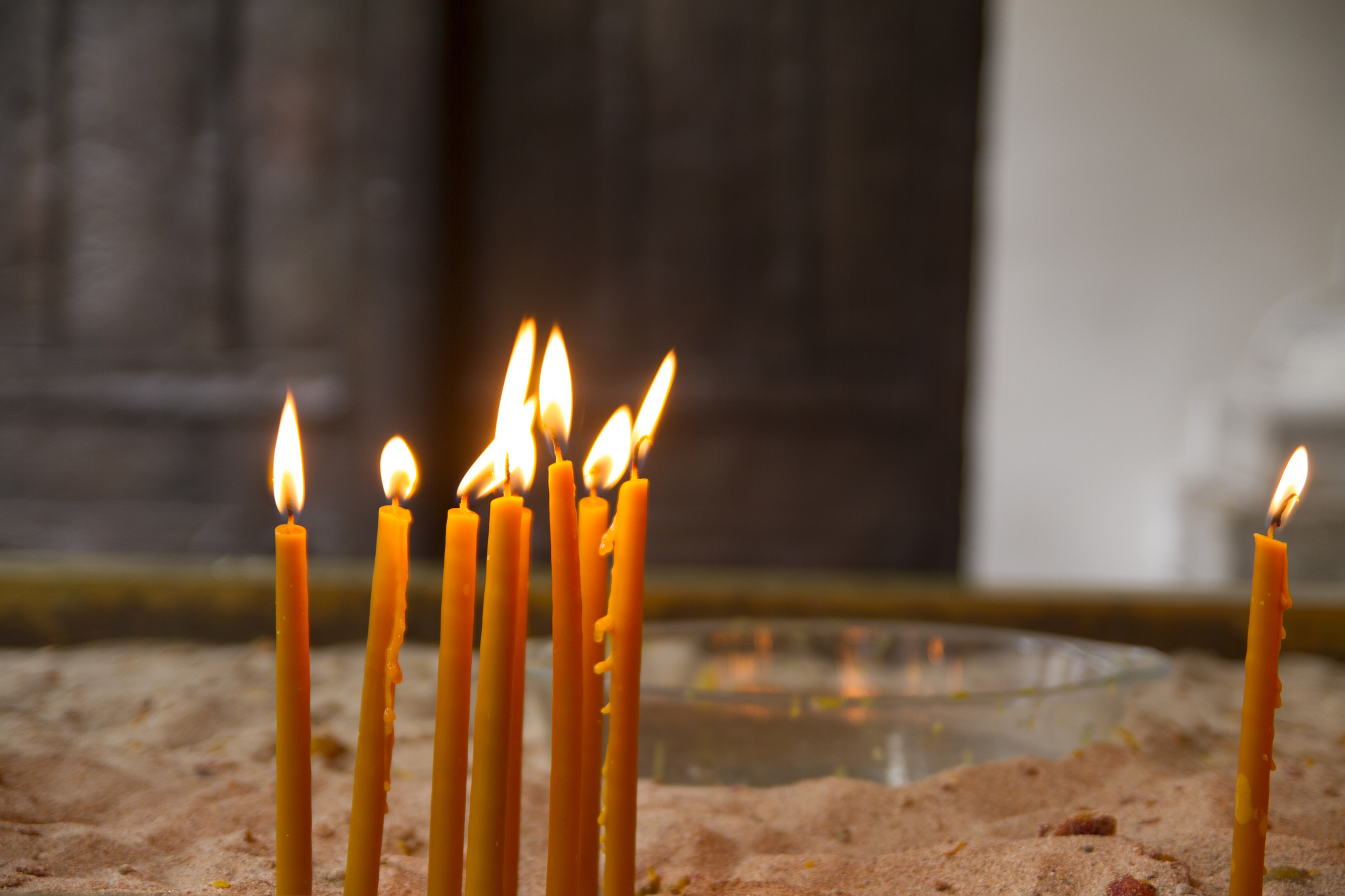Few candles burning in the church.